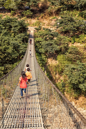 Children Running over Suspension Bridge, Trishuli River, Nepal