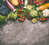 Healthy dieting and antioxidant beverages background with various colorful organic vegetables, fruits and berries smoothies with ingredients in bottles on gray granite table , top view with copy space - 191978767