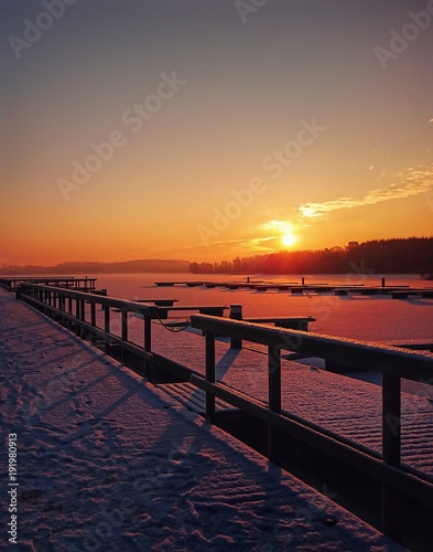 Winter sunrise on the lake of Poland