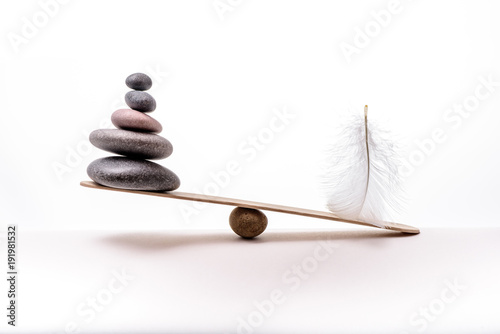 Foto op Canvas Spa Stone balance with plume. Concept of hard and easy.