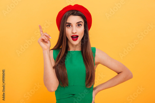 Portrait of an excited young woman dressed in beret
