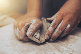 Female potter works with clay, craftsman hands close up - 191986761