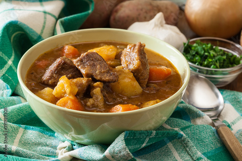 Wall mural Irish stew made with beef, potatoes, carrots and herbs