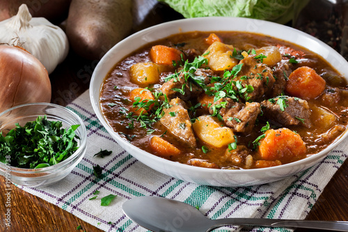 Irish stew made with beef, potatoes, carrots and herbs - 191989738