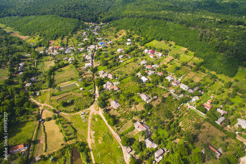 Foto Murales Aerial Shot of Village at Forest