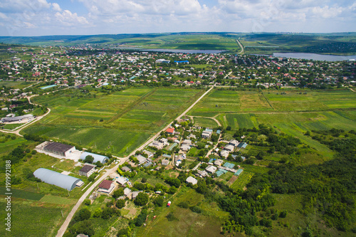 Foto Murales Dron View on Village with Lakes and Fields