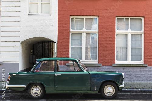 Fotobehang Brugge Old vintage car parked on a street of Bruges, Belgium