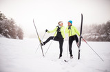 Senior couple cross-country skiing. - 191997345