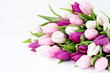 White and pink tulips on white wooden table. Holiday background, copy space - 192001540