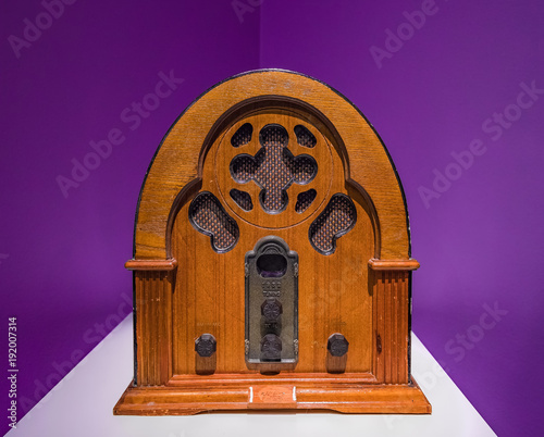 Vintage wood radio from 1930 isolated with purple background.Antique model cathedral.