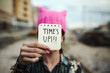 woman with a pink hat and the text time is up - 192014945