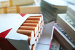 Tobacco Profits With Stacks Of Money Surrounding Cigarettes