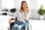 Young woman in wheelchair at workplace - 192039338