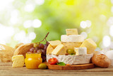 Variety of cheese types composition on wooden board - 192042100