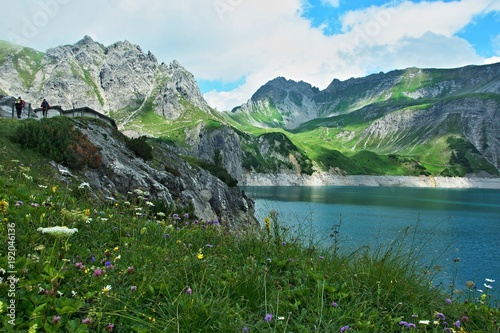 Fotobehang Groen blauw Austrian Alps-view on the lake Lunersee and mountains Ratikon