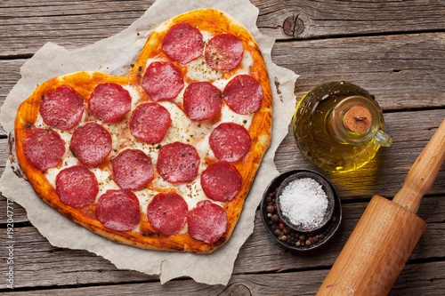 Heart shaped pizza with pepperoni - 192047717