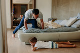 Father and son playing hide and seek in bedroom - 192053143