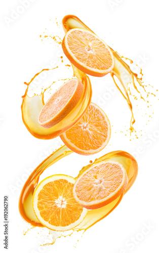 orange slices in juice splash isolated on a white background
