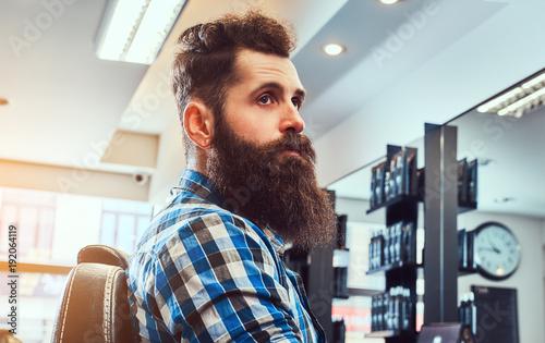 Fotobehang Kapsalon Handsome bearded man in the barbershop.