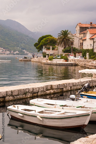 Deurstickers Zalm Boats in harbor and old houses on the coastline in Perast in Kotor Bay in Montenegro