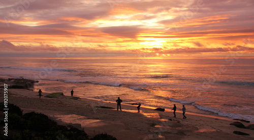 Fotobehang Zee zonsondergang Beachcombers at La Jolla, San Diego, California, watch the sunset