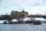 Linlithgow Palace and Loch in winter with snow; the birthplace of Mary, Queen of Scots; situated by Linlithgow Peel, West Lothian, Scotland. - 192078907