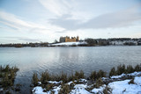 Linlithgow Palace and Loch in winter with snow; the birthplace of Mary, Queen of Scots; situated by Linlithgow Peel, West Lothian, Scotland. - 192078942