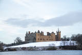 Linlithgow Palace and Loch in winter with snow; the birthplace of Mary, Queen of Scots; situated by Linlithgow Peel, West Lothian, Scotland. - 192078966