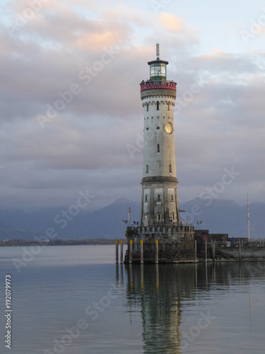 Fotobehang Vuurtoren Historic lighthouse at Lindadu harbor entrance on Lake Constance Germany