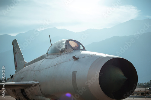 Fotobehang Pool Aircraft fighter against the mountains