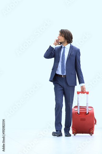 successful businessman with Luggage talking on the phone.