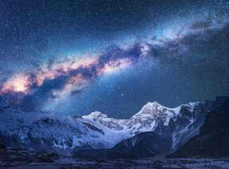 Space. Milky Way and mountains. Fantastic view with mountains and starry sky at night in Nepal. Mountain valley and sky with stars. Beautiful Himalayas. Night landscape with bright milky way. Galaxy
