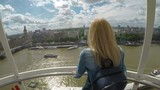 Young tourist woman in vacation admiring the Thames and cityscape from London Eye Millennium Wheel on vacation - 192087971