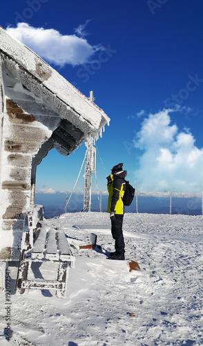 Foto Murales man on Pancic peak, Kopaonik, Serbia winter sunny day snow and ski concept scene