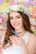 Quadro happy young woman in floral wreath with butterfly on hand