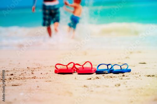 father and son go swim at beach