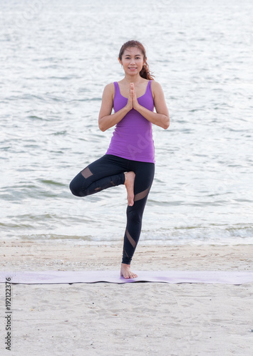 Keuken foto achterwand School de yoga Asia woman doing tree pose and namaste with calm relax emotion at beach,Meditation pose,Wellness and Healthy Lifestyle.