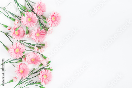 Aluminium Gerbera Flowers composition. Frame made of pink flowers on white background. Flat lay, top view, copy space