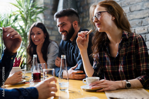 Happy young friends hangout in coffee shop - 192128106
