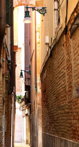 Fototapeta a narrow street of venice