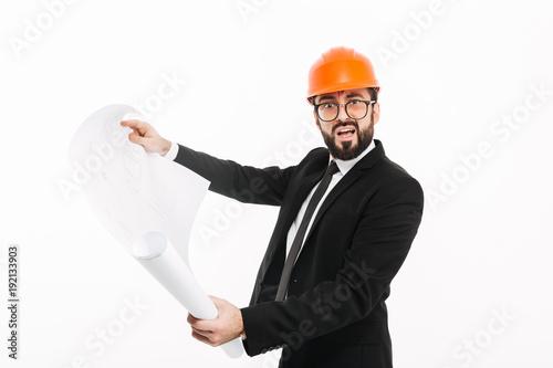 Confused builder engineer wearing helmet holding project.