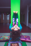 smiling woman practice yoga stretching against column - 192134157