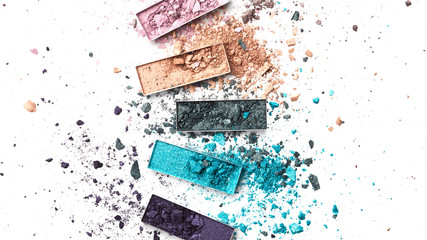 Broken eye shadow palette isolated on white background