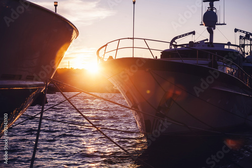 Foto op Canvas Zee zonsondergang Sunset at the port, beautiful yacht in the sun