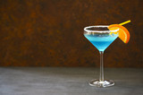 Cocktail Blue lagoon on the dark background - 192143593