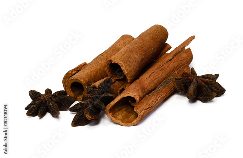 Whole cinnamon and corn snake isolated on white background. Spices for tea and mulled wine