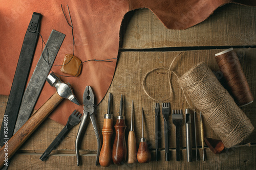 Set Of Leather Craft Tools On Wooden Background Workplace For