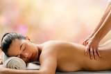 Side view of woman having hot oil massage is spa. - 192148778