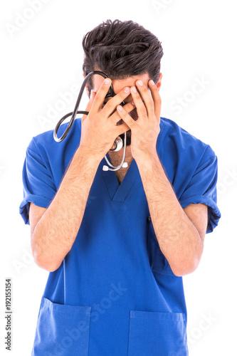 a nurse covering his face