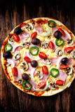 Pizza with Ham, Cherry Tomatoes, Mushrooms and Olives - 192161386